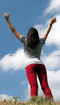 woman with arms raised in success